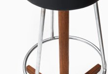 Bar stools in teak, steel and black vinyl at Studio Schalling