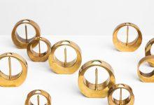 Arthur Pe set of 10 candlesticks in brass at Studio SchallingArthur Pe set of 10 candlesticks in brass at Studio Schalling