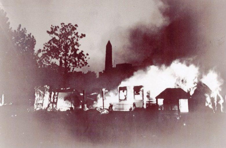 "Photo of Bonus Army Encampment burning, part of the ""business plot"" of 1934"