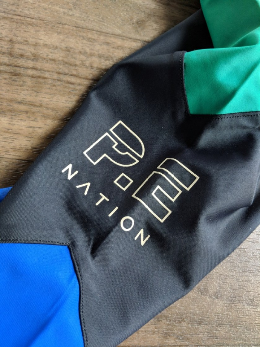 P.E Nation review Riseball Legging Logo