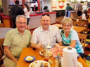Jerry, Curt and Kathy having peach cobbler with Bluebell ice cream! Must be Texas!