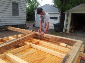 Kyle designing the front wall with engineered beams