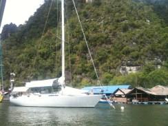 Fishing Village, Langkawi with Off white Yacht Docking
