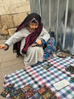Istanbul Old Lady Street Seller Sewing Her Handmade Pouch Live