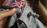 cut a little slit into five out of six stripes and shove the sixth strip through, then make a knot to fixate it
