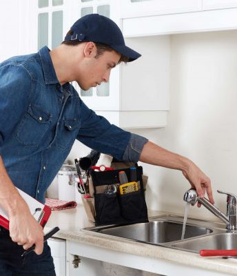 Schober Repair Services | Handyman Services Done Right - Testing a Faucet after installation.