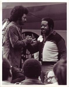 Jackson and Ralph Abernathy clasp hands. Photo by Elaine Tomlin.