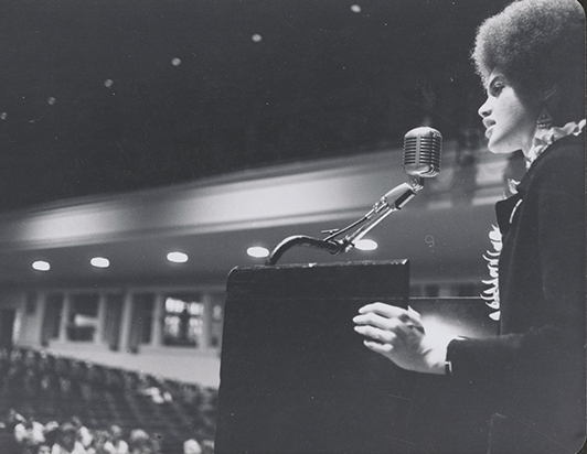 Cleaver speaking at the University of Honolulu in 1968, Rose Library.