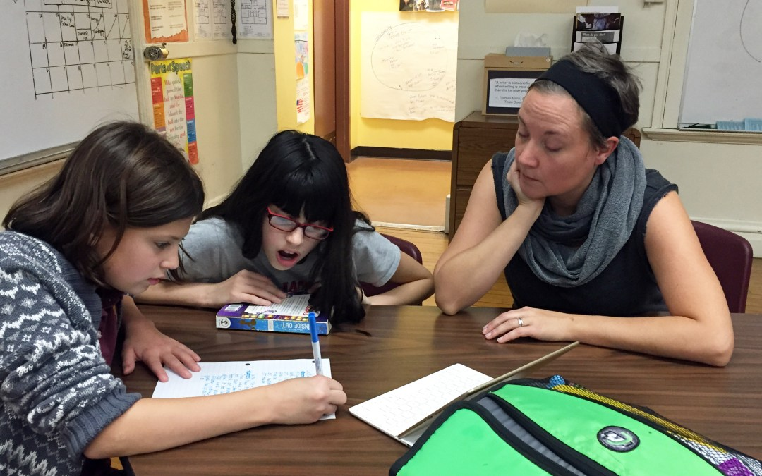 Mrs. May working with students during KIDS Club.