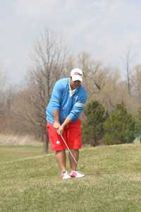 Schoolcraft Sophmore Andrew Ioanou takes a chip shot at the green.