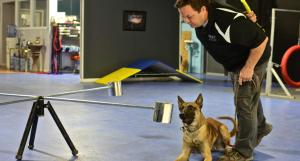 Burkey introduces his dog Kaboom to a smell wheel, which is used in various types of training. PHOTOS BY MARGARET SHAW|STAFF PHOTOGRAPHER