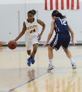 Freshman guard T'era Nesbitt drives the lane past a Mid-Michigan Laker defender in the Ocelot's 75-64 win on Dec. 3. PHOTO BY MARGARET SHAW|STAFF PHOTOGRAPHER