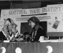 At the School Daze event in 1985, student Renee Chemello, left, and counseling aid Sandy Zgoda promote the Counseling Center with psychic readings at their boot.