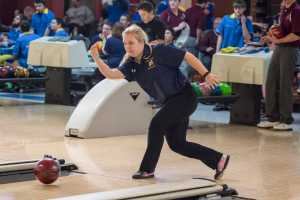 PHOTO BY ANDREW RELLINGER STAFF PHOTOGRAPHER Sophomore Angela Rodriguez rolls for a strike in the Ocelot's home tournament at Merri-Bowl Lanes on Feb. 13. Rodriguez was named to her second consecutive All American Team at the Division III National Tournament in Cheektowaga, NY.