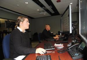 PHOTO BY LAUREN LUKENS|EDITOR-IN CHIEF Intelligence Operations Center technicians Kristen Robinson, left, and Raymond Brydak III maintain the Campus Police Authority Twitter page, as well as monitor other social media sites for potential dangers.