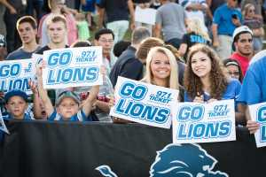 Thousands of faithful Detroit Lions fans flock to Novi High School to support the team during their first open practice.