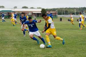 Photos by: Alex Regish Staff Photographer Sophomore Forward Victor Contreras battles a Lakeland defender for possession of the ball on October 4th at Schoolcraft College.
