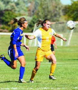 Photo by Jake Mulka | Photo Editor Above: Sophomore forward Shae van Gassen (16) battles a Muskegon defender for the possesion of the ball.