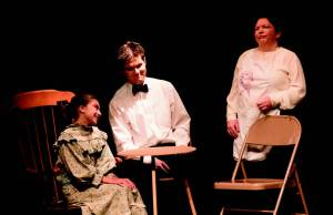 The Gibbs family, sharing an early morning laugh. Left to right: Gina Couyoumjian (Rebecca), John Mullen (George), Melissa Benglian (Mrs. Gibbs).