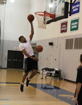 Forward Carlos Taylor practices his rebounding and layups in preparation for this year's season.