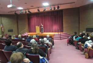 """Judy Sima telling the story of """"Sir Gawain and the Loathly Lady"""" at the 2015 Tellabration Event."""