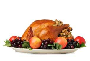 picture of a cooked turkey with stuffing and fruit