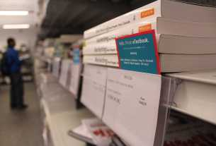 Textbooks on a shelf in a college bookstore