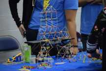 A toothpick fort is delicately on display to show the importance of precision.