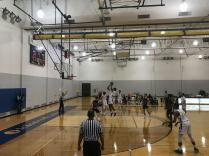 Kemon Bassett, #12, makes a shot when Alex Ismail, #44, are trying his best to defend the Lumberjacks