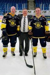 Schoolcraft general manager, Rob Lindsay (center) is surrounded by his two sons, Robert Lindsay Jr. (left) and Andrew Lindsay (right). Both sons are currently Michigan State Troopers. Andrew, is a former captain of the Schoolcraft team and helped start the program five years ago.