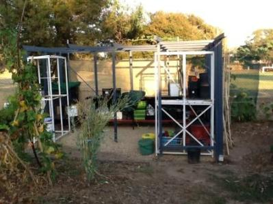 painted and furnished with scavenged benches an shelves, our shadehouse looks like it's always been there