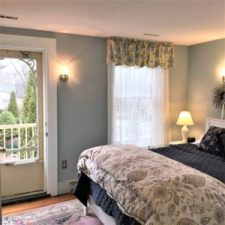 The Garden View Suite - bright and cheerful with a queen bed and private entrance