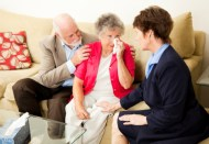 Senior couple sees a therapist to cope with grief. Could also be funeral director meeting with clients.