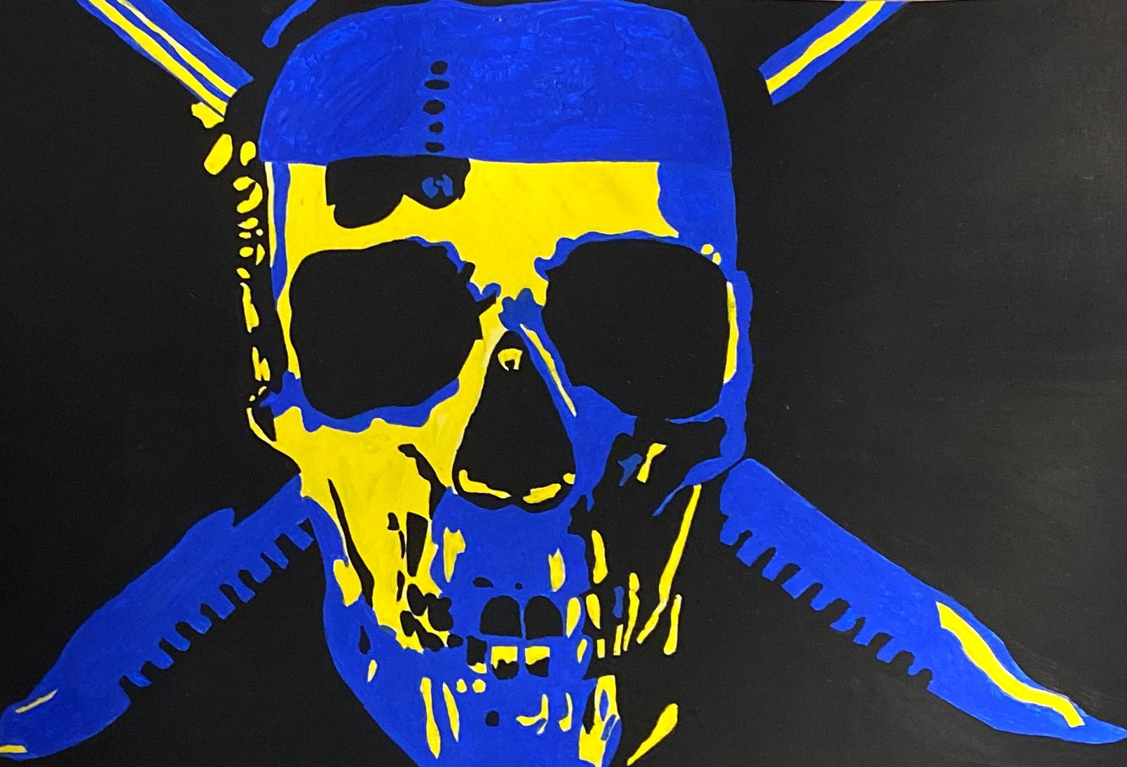 skull and crossed swords in blue and yellow