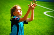 Photograph of Primary phase student reaching for the ball whilst playing sport at NNord Anglia International School Dubai