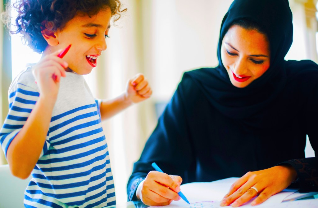 Photograph of a student learning Arabic in a Dubai School showing the teacher conducting a happy inspirational lesson