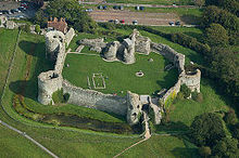 William ordered a Castle to built to protect his men from attack in the early stages of the Norman Invasion. Pevensey Castle was later built in stone, shown here.