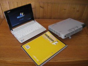 The yellow notebook shows you how compact my Acer netbook and Casio data projector are.  Everything fits into a backpack.
