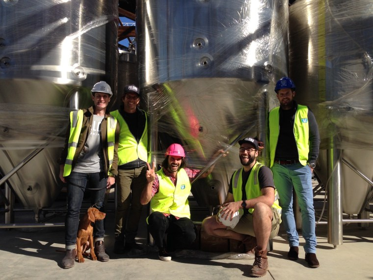 Felons Brewing (left to right) - Ash Cranston (Felons General Manager), Astro (brewery dog), Adam Flaskas (Howard Smith Wharves Director), Dean Romeo (Felons brand manager), Tom Champion (Felons Head Brewer), Luke Fraser (Howard Smith Wharves CEO)