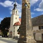 Elsterwerda, Postsäule und Kirche