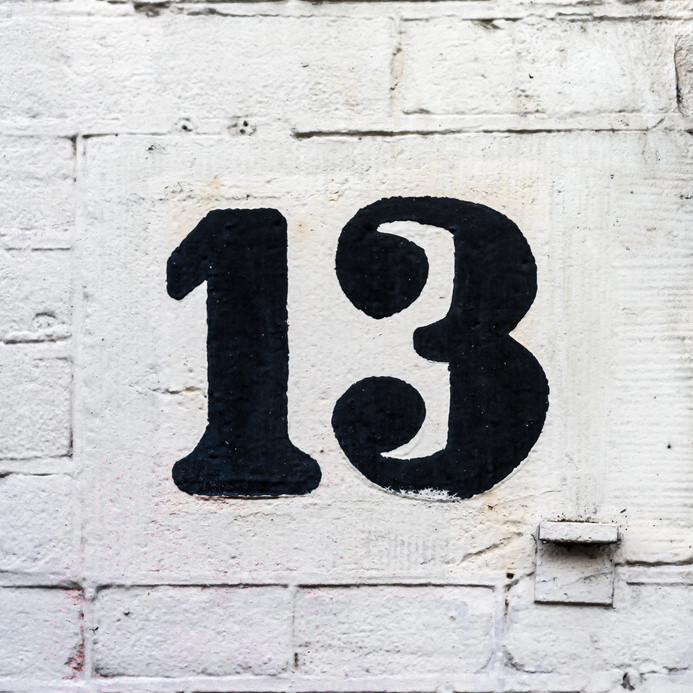 hand painted house number thirteen