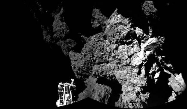 Rosetta's lander Philae is safely on the surface of Comet 67P/Churyumov-Gerasimenko, as this mosaiced CIVA image confirms. One of the lander's three feet can be seen in the foreground. The image above is a two-image mosaic.