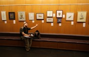 """Jeremy is pointing to third place entry, Trish Murphy's """"Cinnabar Polypore"""". Second place entry, Emily Damstra's """"Devonian Placoderm"""" is second from right."""