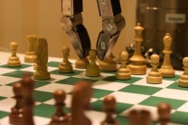 Georgia Tech's Golem Chesster playing chess at AAAI 2010 by Jiuguang Wang. Flickr.(CC BY-SA 2.0)