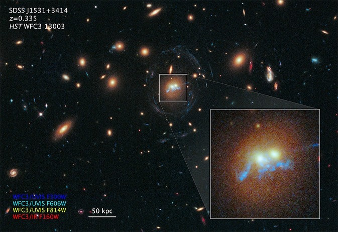 Hubble Spots Spiral Bridge of Young Stars Linking Two Ancient Galaxies