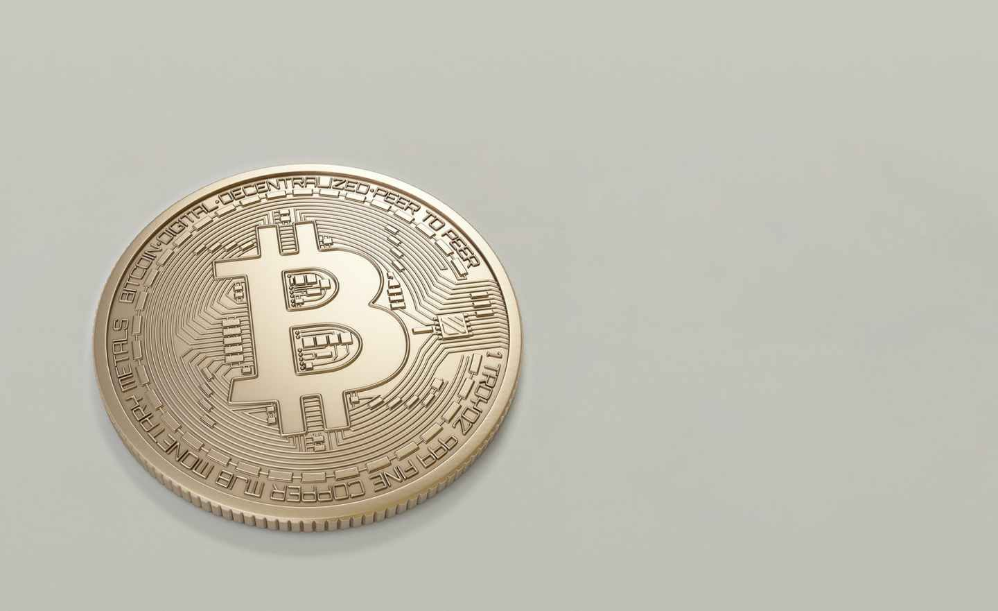 round gold colored bitcoin