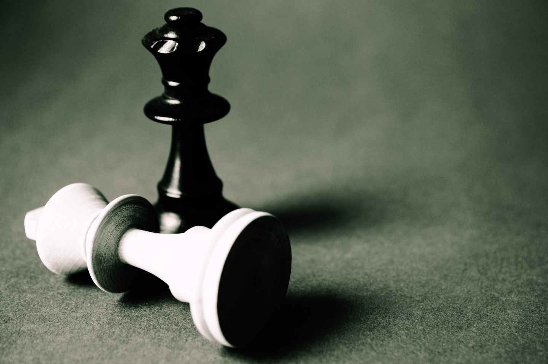black queen chess piece standing