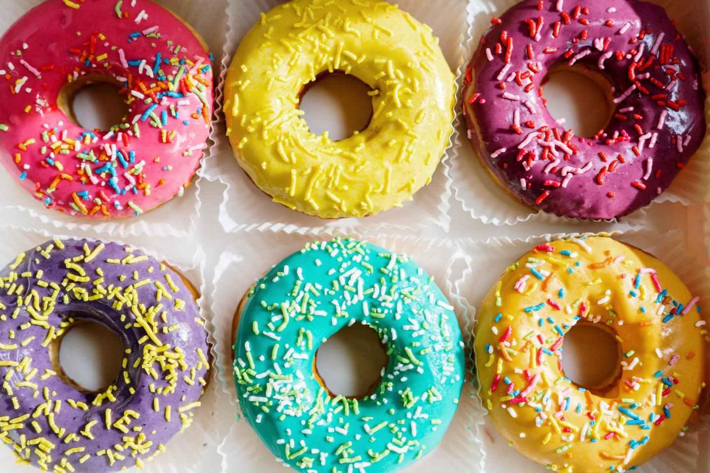 pink doughnut on white textile