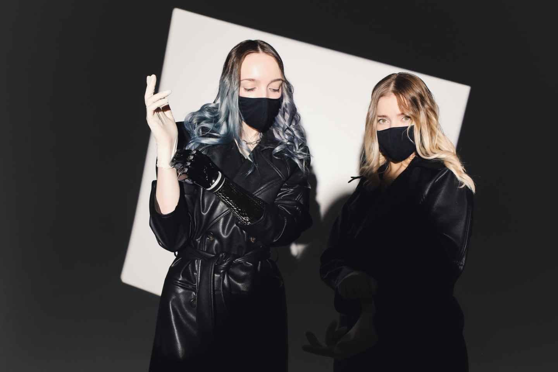 photo of woman wearing black mask