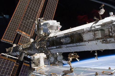 Starboard truss of the ISS, with Alpha Magnetic Spectrometer-2 (AMS) visible at center left.